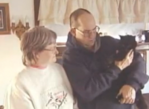 Mary and Al Palusky with their ancient cat, Baby.